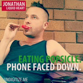 Eating Popsicle. Phone Faced Down.