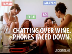 Chatting Over Wine. Phone Faced Down.