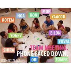Team Meeting. Phone Faced Down.