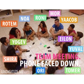 Team Meeting. Phone Faced Down.