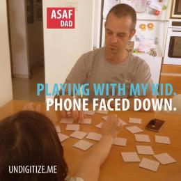 Playing With My Kid. Phone Faced Down.