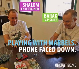 Playing With Marbles. Phone Faced Down.