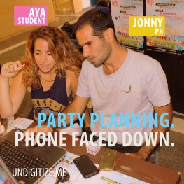 Party Planning. Phone Faced Down.