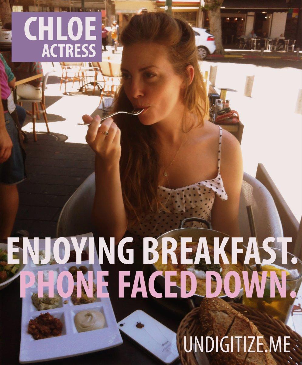 Enjoying Breakfast. Phone Faced Down.