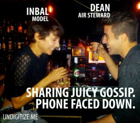 Sharing Juicy Gossip. Phone Faced Down.