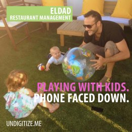 Playing With Kids. Phone Faced Down.