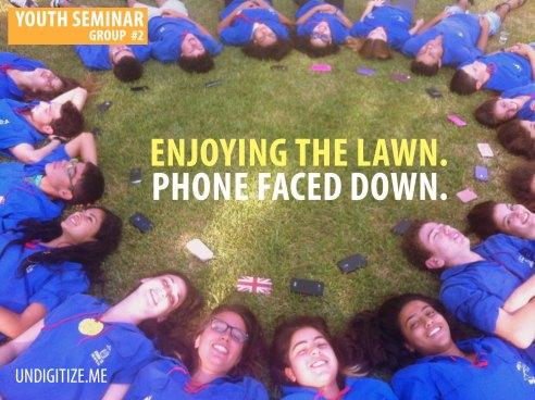 Enjoying The Lawn. Phone Faced Down.