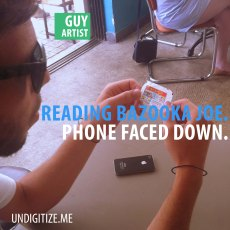 Reading Bazooka Joe. Phone Faced Down.