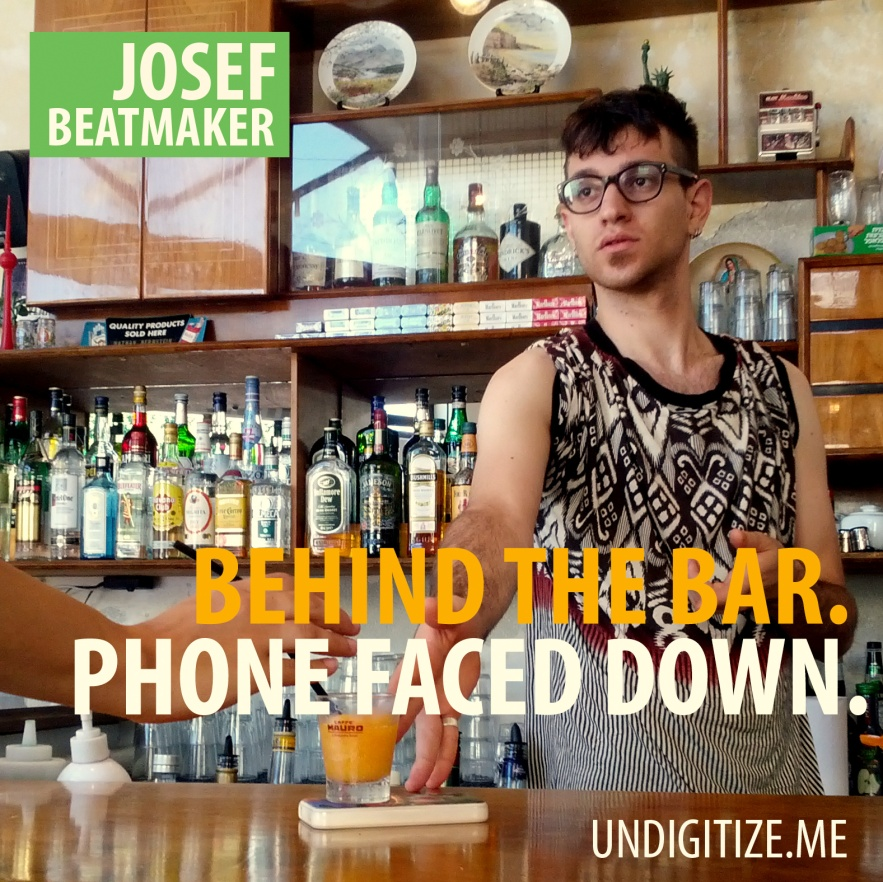 Behind The Bar. Phone Faced Down.