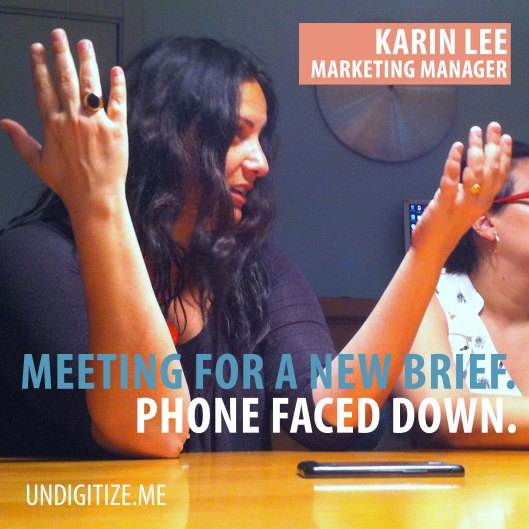 Meeting For A New Brief. Phone Faced Down.