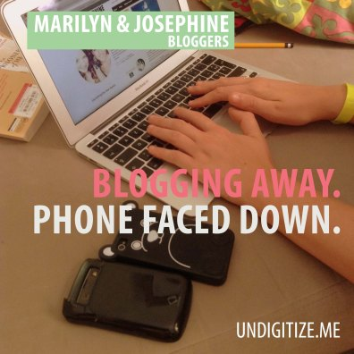 Blogging Away. Phone Faced Down.