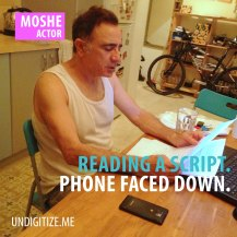 Reading A Script. Phone Faced Down.