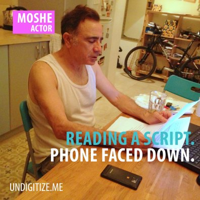 Reading A Script. Phone Faced Down.