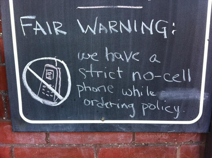 No cell phone while ordering policy
