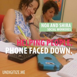 Helping People. Phone Faced Down.