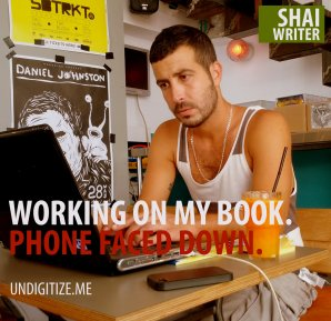 Working On My Book. Phone Faced Down.