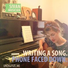 Writing A Song. Phone Faced Down.