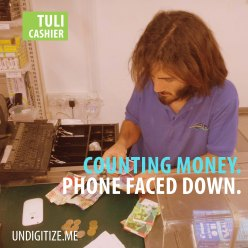 Counting Money. Phone Faced Down.