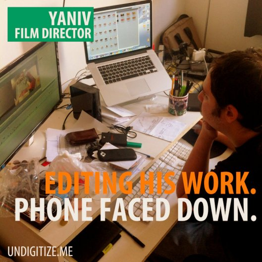 Editing His Work. Phone Faced Down.
