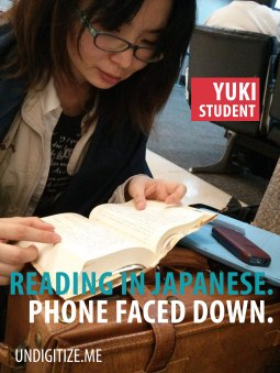 Reading In Japanese. Phone Faced Down.